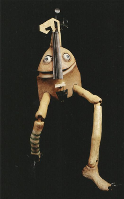 Marioneta de violín, en <em>Fiddlesti<em>c</em>ks</em> (2002) por Garli<em>c</em> Theatre, un espe<em>c</em>tá<em>c</em>ulo sobre el espíritu de un violín roto. Foto: Garlic Theatre