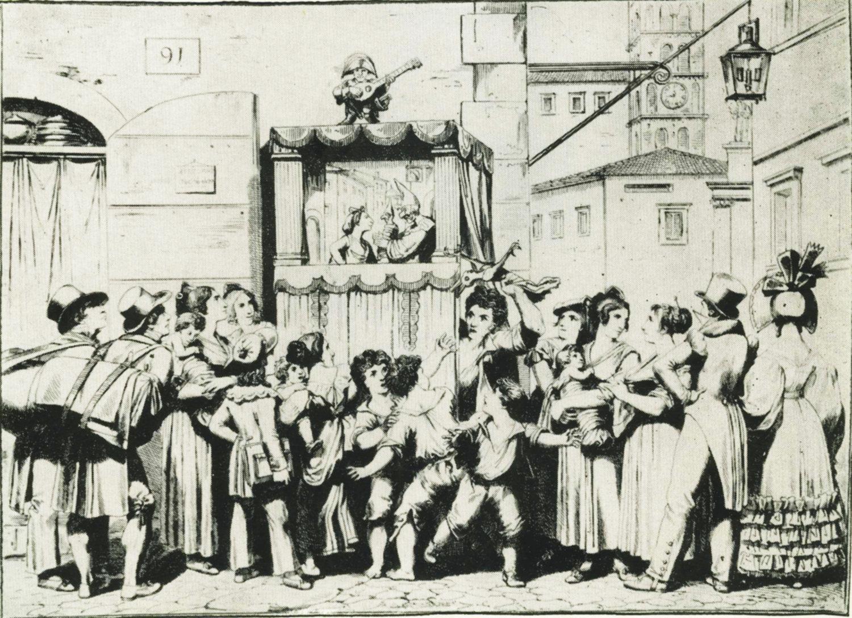 Une gravure datant de 1830 par l'illustrateur et graveur italien Bartolomeo Pinelli (1781-1835) d'un spectacle de rue de marionnettes réalisé dans un <em>casotto</em> (castelet ambulant) par le marionnettiste italien itinérant, Ghetanaccio. Collezione Maria Signorelli