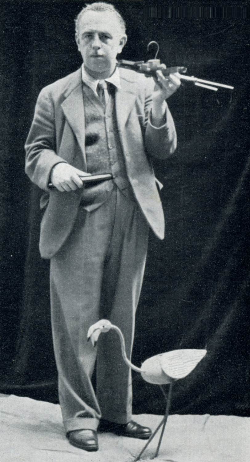 H.W. Whanslaw (1883-1965), prolific author, illustrator, puppeteer, founder of The British and Model Theatre Guild, with <em>flamingo</em> string puppet. Photo courtesy of Collection: The British Puppet and Model Theatre Guild