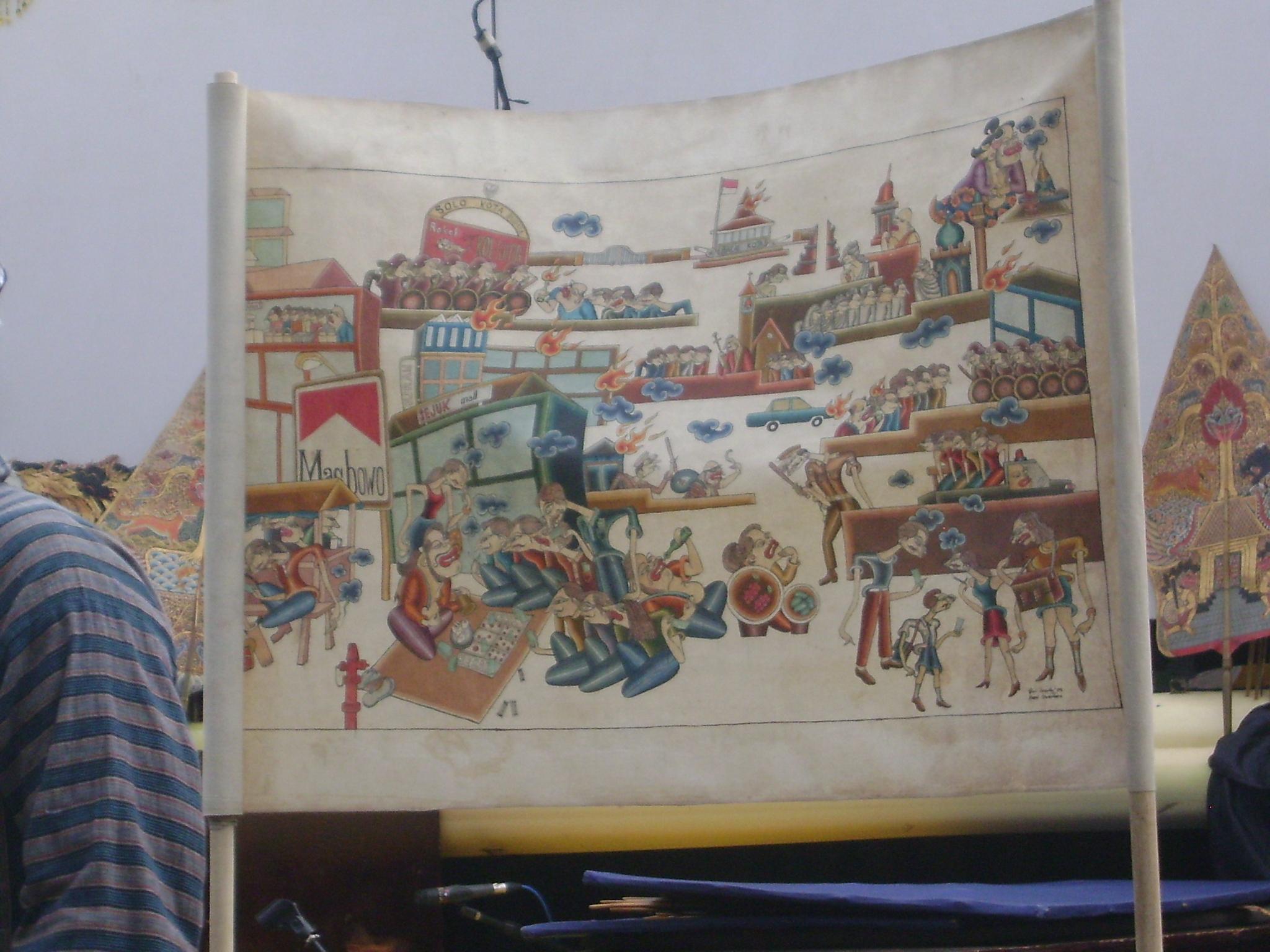 <em>Wayang beber Metropolitan</em>, compagnie de théâtre de Jakarta qui raconte des histoires contemporaines à l'aide de gros rouleaux peints, la version moderne du wayang beber.