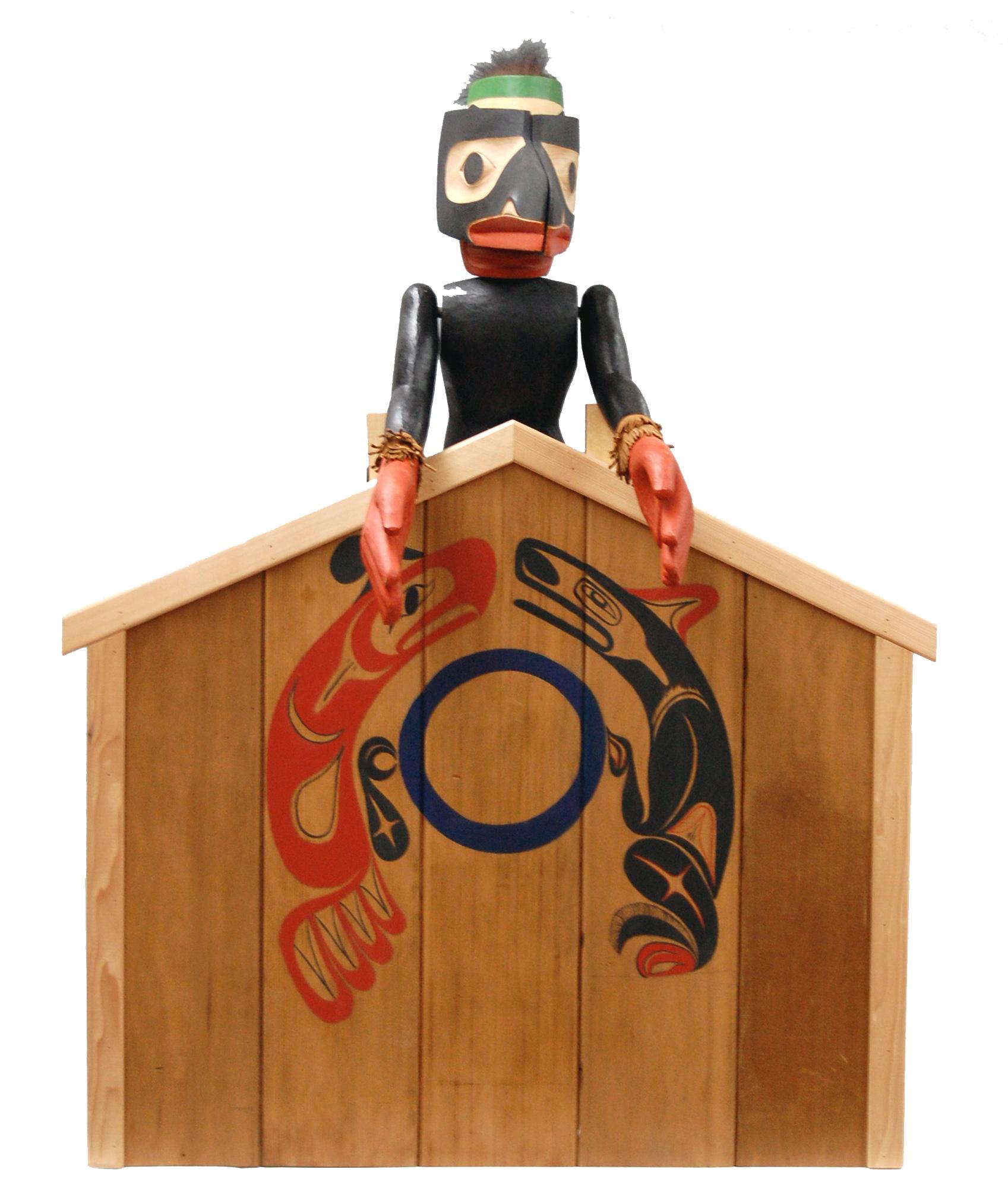 Marionnette à tiges de métamorphose d'un corbeau par George David, un membre des Nuu-chah-nulth / Nuučaan̓uł (Côte Nord-Ouest du Pacifique au Canada)