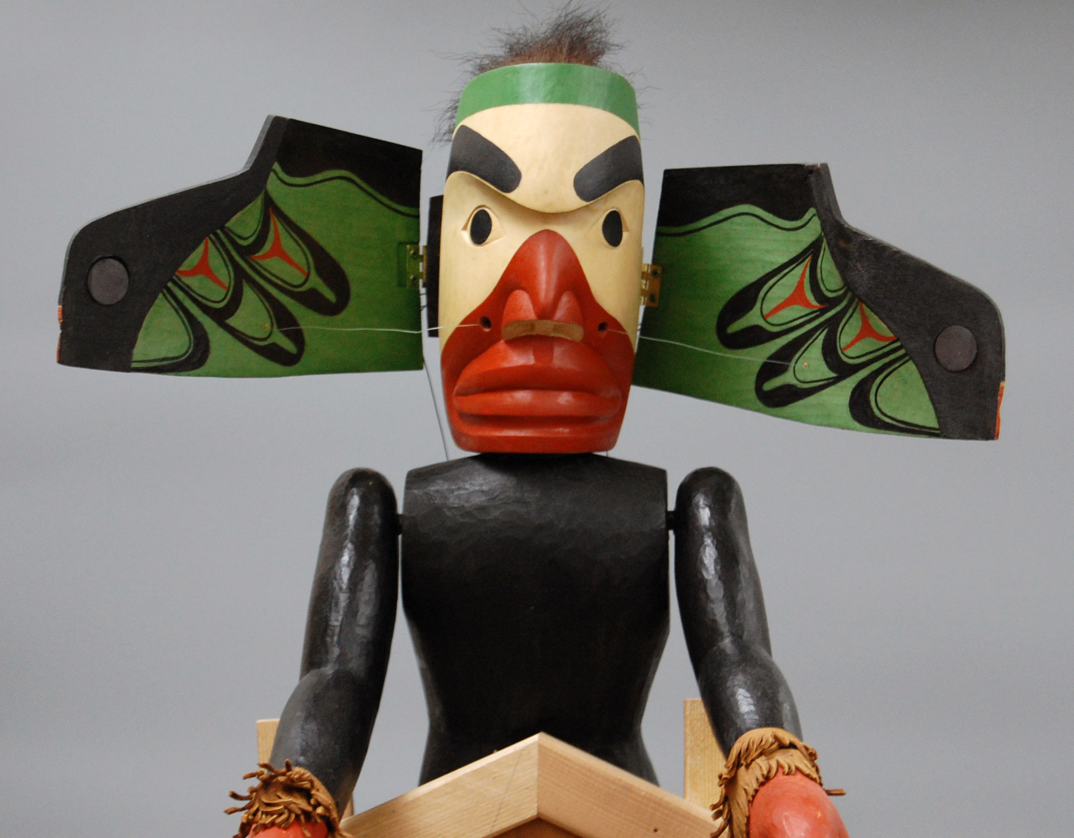 Transformation rod puppet of a raven by George David, a member of the Nuu-chah-nulth / Nuučaan̓uł people (Pacific Northwest, Canada). Head opens to reveal the wings of the raven. Photo courtesy of Center for Puppetry Arts